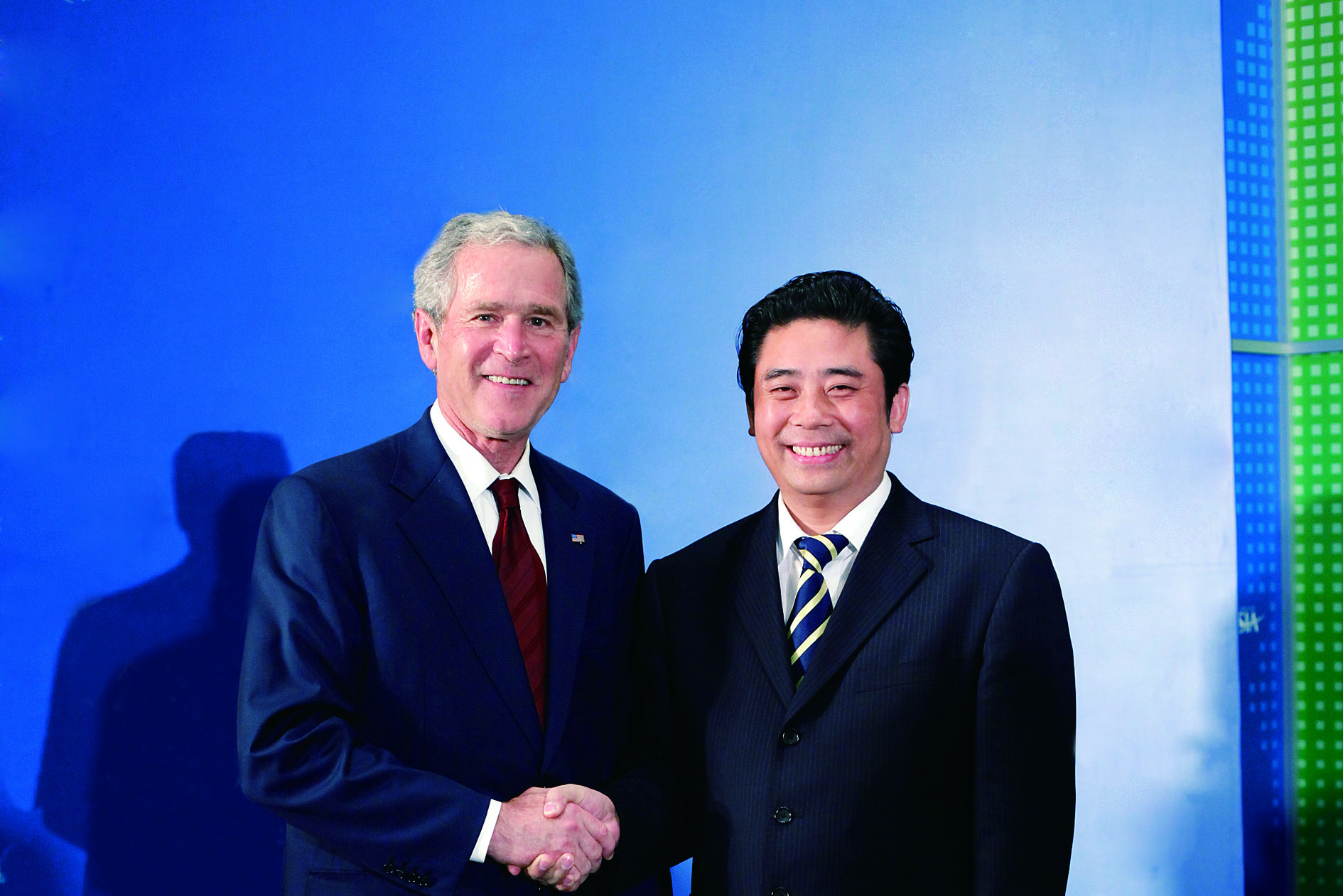 Mr. Junqing Lu meeting with George W. Bush, former President of the United States