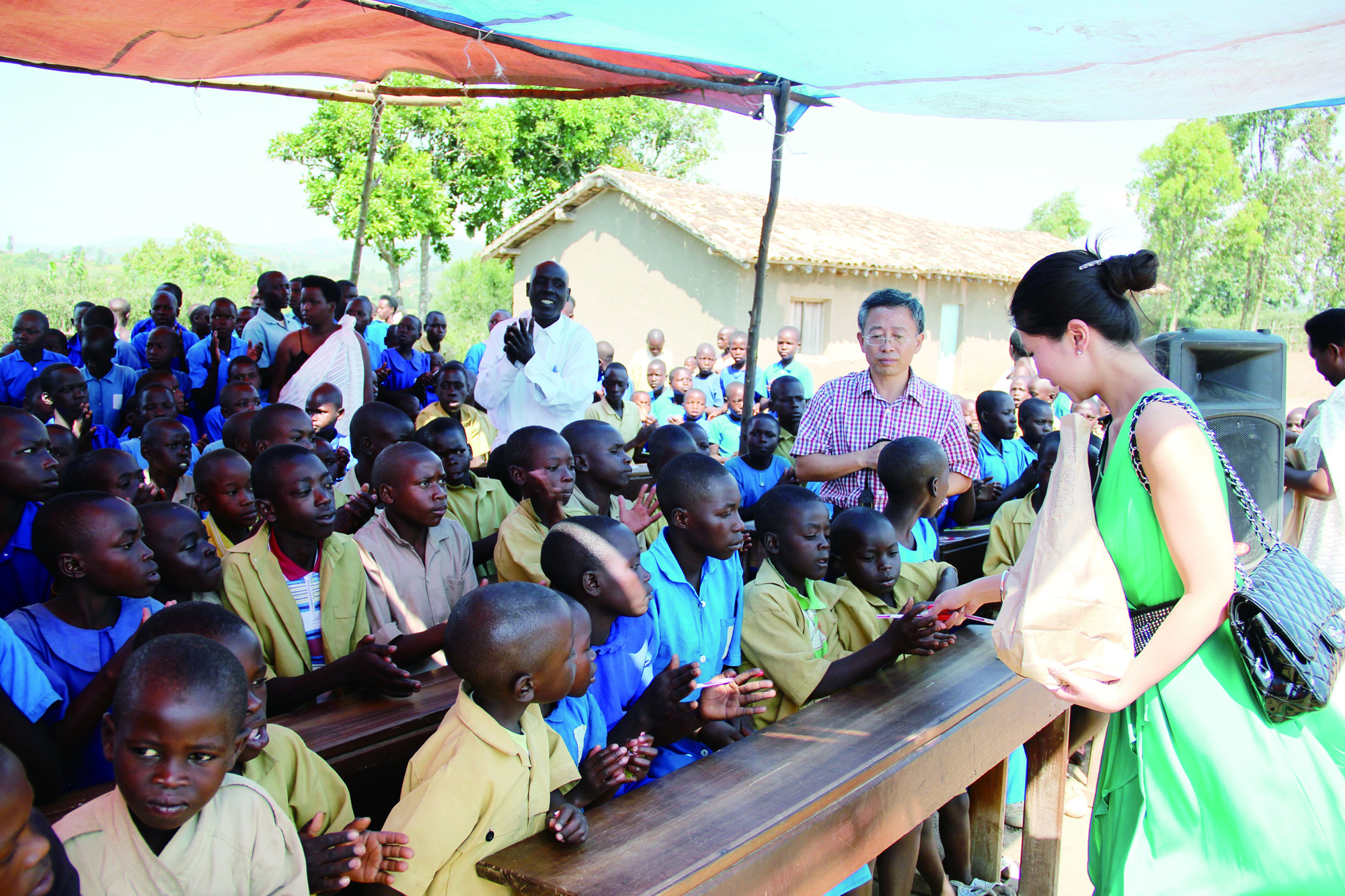 Ms. Xingyu Lu donating learning equipment to children in Africa