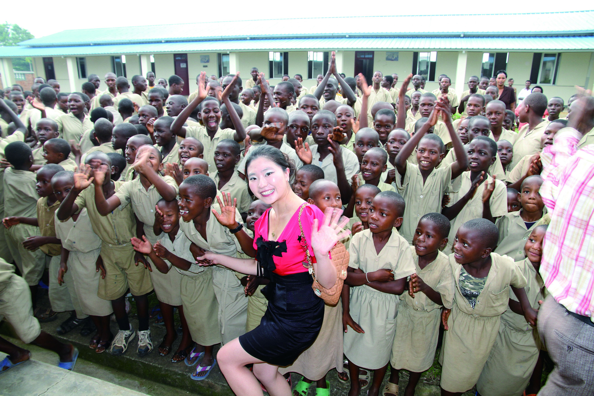 Ms. Xingyu Lu visiting students in Africa